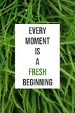 Inspirational poster Every moment is a fresh beginning stock images