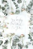 Inspirational quote be happy, be bright, be you written in calligraphy style on paper with pink roses and eucalyptus branches on stock images