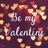 Inspirational quote be my valentine on bokeh heart Stock Photo