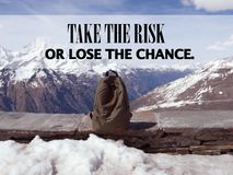 Inspirational Quote about chance. Inspirational Motivational Quote `Take the risk or lose the chance` on blurred bag and snow mountain background with vintage Stock Photo