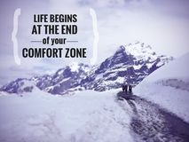 Inspirational quote about comfort zone. Inspirational Motivational quote `Life begins at the end of the comfort zone` on blurred snow mountain background with Royalty Free Stock Photos