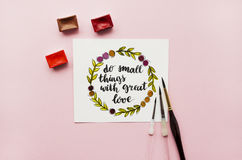 Inspirational quote `do small things with great love`, watercolor, brushes on a pink background Royalty Free Stock Photos