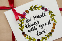 Inspirational quote `do small things with great love` written in calligraphy style Royalty Free Stock Photography