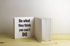 Inspirational quote. `do what they think you can`t do` on blurred background with vintage filter stock photography