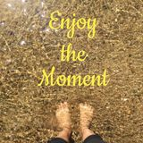 Inspirational quote. `enjoy the moment` on blurred water background Stock Photos