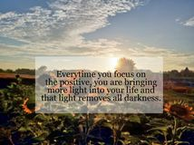 Inspirational quote- Every time you focus on the positive, you are bringing more light into your life and that light removes all. Darkness. With blurry royalty free stock image