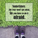 Inspirational quote about fear. Inspirational quote `sometimes the fear won`t go away,so you have to do it afraid` on blurred background with vintage filter Royalty Free Stock Photography