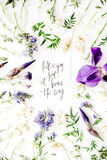 Inspirational quote `follow your soul it knows the way` written in calligraphy style on paper with wreath frame with purple iris f Stock Images