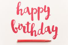 Inspirational quote `Happy birthday` for greeting cards and posters. Inspirational phrase `Happy birthday` for greeting cards and posters drawing with red stock photo