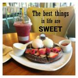 Inspirational quote. `the best things in life are sweet` on blurred waffle background Royalty Free Stock Image