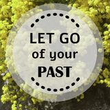 Inspirational quote `Let go of your past`. On blurred background Stock Image