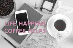Inspirational quote `Life happens coffee helps. ` on black and white background Stock Photos