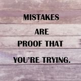 "Inspirational quote ""mistakes are proof that you're trying. Inspirational quote ""mistakes are proof that you're trying"" on blurred wood planks Stock Images"