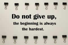 Inspirational quote. Inspirational Motivational quote `Do not give up,the beginning is always the hardest` on blurred background Stock Image