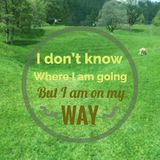 Inspirational quote. Inspirational Motivational quote `I don`t know where I am going but I am on my way` on blurred green field background Royalty Free Stock Photo