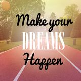 Inspirational quote. Inspirational Motivational quote `make your own dreams happen` on blurred running track background with vintage filter Royalty Free Stock Image