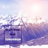 Inspirational Quote. Inspirational Motivational quote `Start now, not tomorrow` on blurred snow mountain background with vintage filter Royalty Free Stock Photo