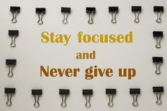 Inspirational quote. Inspirational Motivational quote `Stay focused and never give up` on blurred background Stock Image