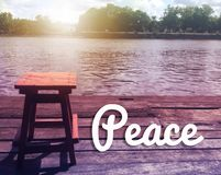 Inspirational quote. `Peace` on blurred background with vintage filter Stock Images