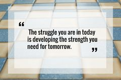 Inspirational quote about power. Inspirational motivational quote `the struggle you are in today is developing the strength you need for tomorrow` on chess table Stock Photo