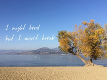 Inspirational quote on scenic autumn lake landscape.I might bend but I won`t break. Inspirational quote on scenic autumn lake and mountains landscape with clear royalty free stock photography