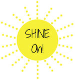 Inspirational Quote: Shine On!. In typography set in a bright yellow sun with rays stock illustration