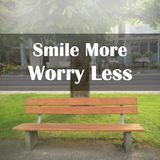 Inspirational quote `Smile more worry less`. On blurred background with vintage filter Stock Image