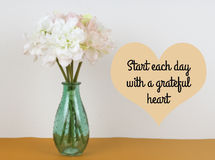 Inspirational quote. `start each day with grateful heart` on blurred background with vintage filter stock photography