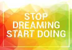 Inspirational quote. Stop dreaming start doing. wise saying in square on colorful triangle background Stock Photo