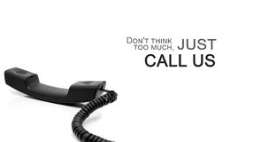 Inspirational quote and telephone handset. Stock Photo