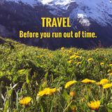 Inspirational quote. `Travel before you run out of time` on blurred background Royalty Free Stock Photo