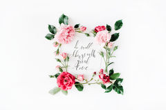 Inspirational quote `what is done in love is done well` written in calligraphy style on paper with pink, red roses, chamomiles and Stock Image