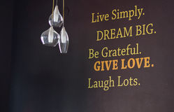 Inspirational quoteon the wall. Stock Photo