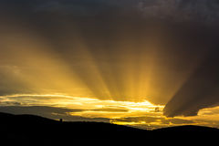 Inspirational rays. Rays of sunlight emerging from the clouds Stock Photo