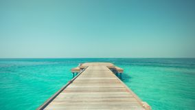 Inspirational sea and sky view with horizon and relaxing colors. Inspire and motivational sea background with wooden pier pathways. Calm sea nature concept stock images