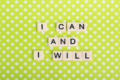 Inspirational sentence formed with game tiles. Motivation and inspiration related sentence formed with game tile letters stock photos