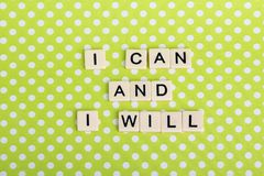 Inspirational sentence formed with game tiles. Motivation and inspiration related sentence formed with game tile letters stock photo