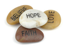 Inspirational Stones. Pile of stones carved with inspirational words Royalty Free Stock Photos