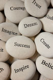 Inspirational stones. Close up of engraved stones stock photography