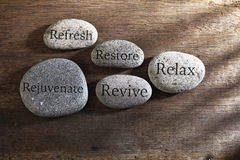 Inspirational stones. Pebbles or stone with text  Relax, restore, refresh, rejuvenate and revive text on zen stones Royalty Free Stock Photos