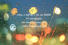 Inspirational Typographic Quote - Falliing in love is like the rain Royalty Free Stock Photos