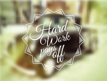 Inspirational Vintage Typo: Hard Work Pays Off with blurred background. Stock Photo