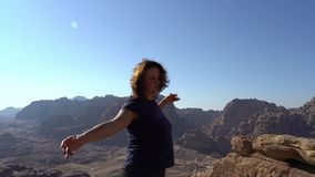 Inspirational woman enjoy life, dancing outdoors at the edge of mountains, lifestyle travel concept, cinematic