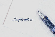 Inspirational writing. Fountain pen on white paper with the word 'inspiration Royalty Free Stock Images