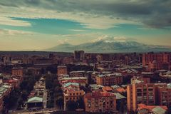 Inspirational Yerevan cityscape. Travel to Armenia. Tourism industry. Mount Ararat on background. Dramatic sky. Armenian architect. Ure. City tour. Urban Stock Images