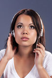 Inspire. Young woman listening music in headphones Royalty Free Stock Images