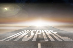 Inspire against road leading out to the horizon Stock Photography