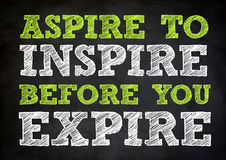 INSPIRE concept on chalkboard. INSPIRE concept written on chalkboard royalty free stock photography