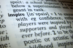 Inspire dictionary definition. Close up of the word inspire dictionary definition royalty free stock photo