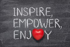 Inspire, empower, enjoy. Words written on chalkboard with red heart symbol instead of O royalty free stock photos